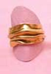 gold ring that looks like fabric has been folded or compressed together.